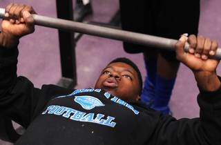 Desert Pines High School football player Tim Hough works out inside the school weight room Thursday, Jan. 9, 2013.