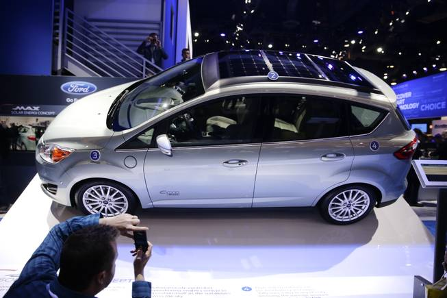 The Ford C-MAX Solar Energi Concept car is unveiled at the International Consumer Electronics Show on Tuesday, Jan. 7, 2014, in Las Vegas.