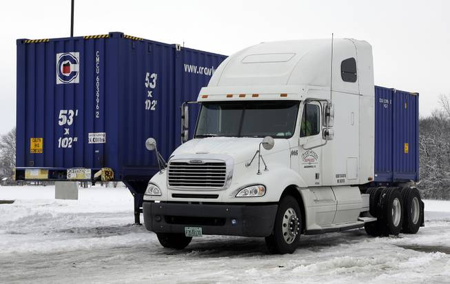 This is the tractor trailer under which Tim Rutledge, 53, of Orlando, Fla., says he crawled before dawn Monday to fix its frozen brakes when it suddenly settled deeper into the snow, pinning him beneath an axle. It remains at a truck stop in Whiteland, Ind., Thursday, Jan. 9, 2014.