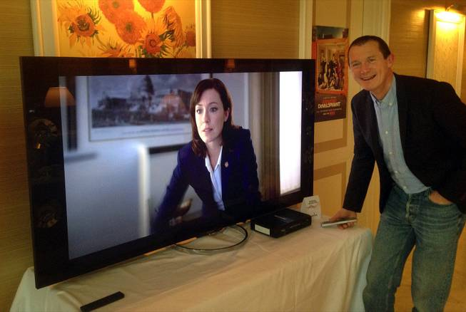 "Neil Hunt, Netflix's chief product officer, demonstrates ultra high definition streaming of a ""House of Cards"" trailer on a Sony TV on the sidelines of the International Consumer Electronics Show in Las Vegas."