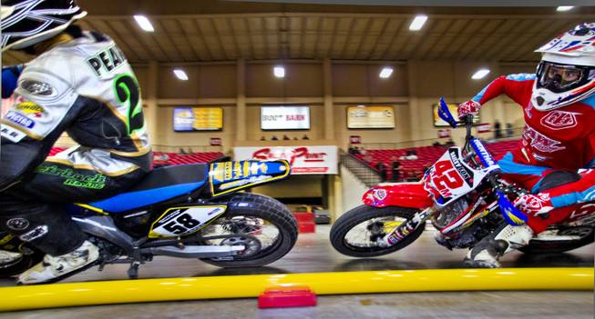 Riders Rob Pearson (58) and Bailey Fox (42M) battle for position during their heat in the West Coast Flat Track Series Races at South Point on Friday, Jan. 10, 2014.