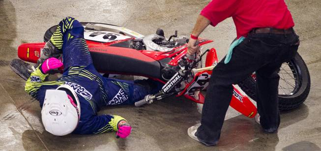 Rider Kyle Jones (94J) has his leg trapped after a fall during a heat race in the West Coast Flat Track Series Races at South Point on Friday, Jan. 10, 2014.