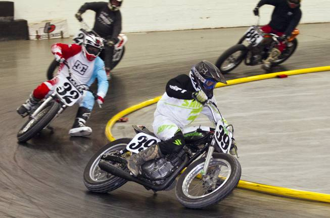 Rider Dale Hansen (39J) races to victory in the Vintage Class during the West Coast Flat Track Series Races at South Point on Friday, Jan. 10, 2014.