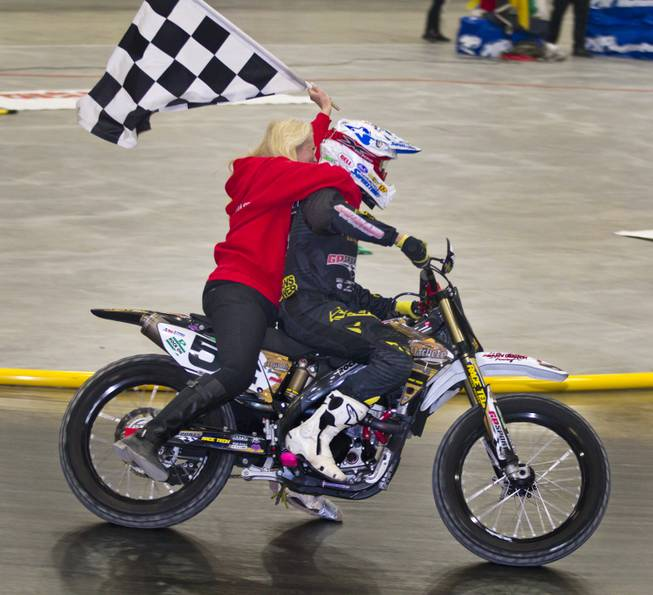 Rider Mike Rush (54) takes a victory lap after winning the Open Class finals of the West Coast Flat Track Series Races at South Point on Friday, Jan. 10, 2014.