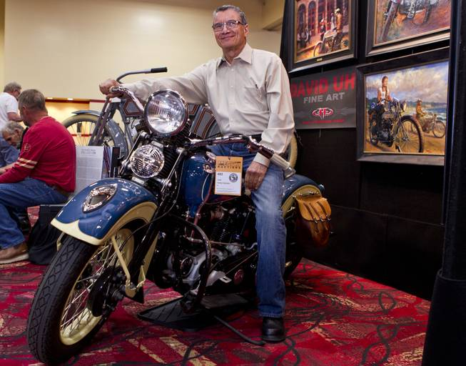 George Pardos with one of his favorite bikes in his collection, Evolution of the Harley-Davidson Motorcycle, showcasing 20 historic first-year Harley-Davidson motorcycles from 1911-1965 up for auction at South Point on Friday, Jan. 10, 2014.