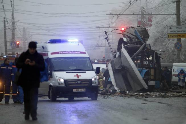 An ambulance leaves the site of a trolleybus explosion in Volgograd, Russia, Monday, Dec. 30, 2013. The explosion left 10 people dead, a day after a suicide bombing that killed at least 17 at the city's main railway. The explosions put the city on edge and highlighted the terrorist threat that Russia is facing as it prepares to host the Winter Games in February. Volgograd is about 650 kilometers (400 miles) northeast of Sochi, where the Olympics are to be held.