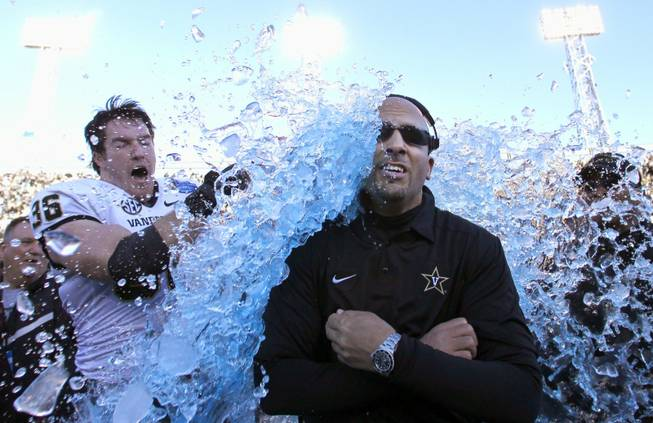 Vanderbilt coach James Franklin is doused by linebacker Chase Garnham after the Commodores defeated Houston 41-24 in the BBVA Compass Bowl NCAA college football game on Saturday, Jan. 4, 2014, in Birmingham, Ala.