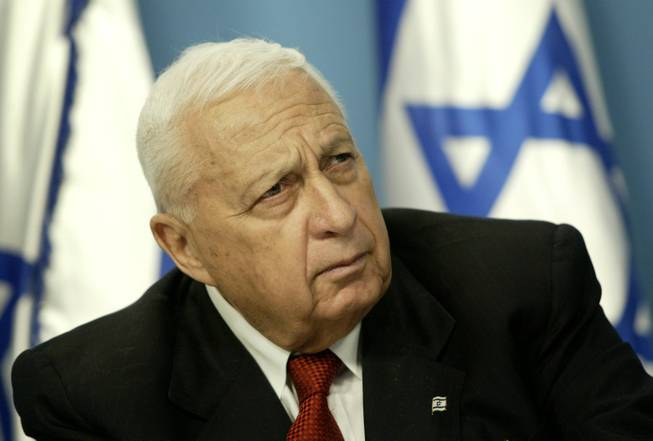 In this Sunday May 16, 2004, file photo, Israeli Prime Minister Ariel Sharon pauses during a news conference in his Jerusalem office regarding education reform. Sharon, the hard-charging Israeli general and prime minister who was admired and hated for his battlefield exploits and ambitions to reshape the Middle East, died Saturday, Jan. 11, 2014. The 85-year-old Sharon had been in a coma since a debilitating stroke eight years ago.