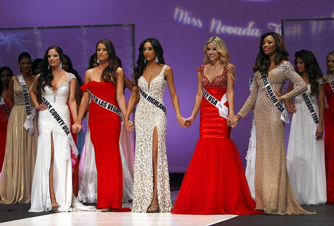 Finalists, from left, Jessica Davis, Nia Sanchez, Brittany McGowan, Stephanie Cook, and Cierrra Jackson, wait on stage during the Miss Nevada USA pageant at UNLV Sunday, Jan. 12, 2014. Sanchez was later named Miss Nevada USA.