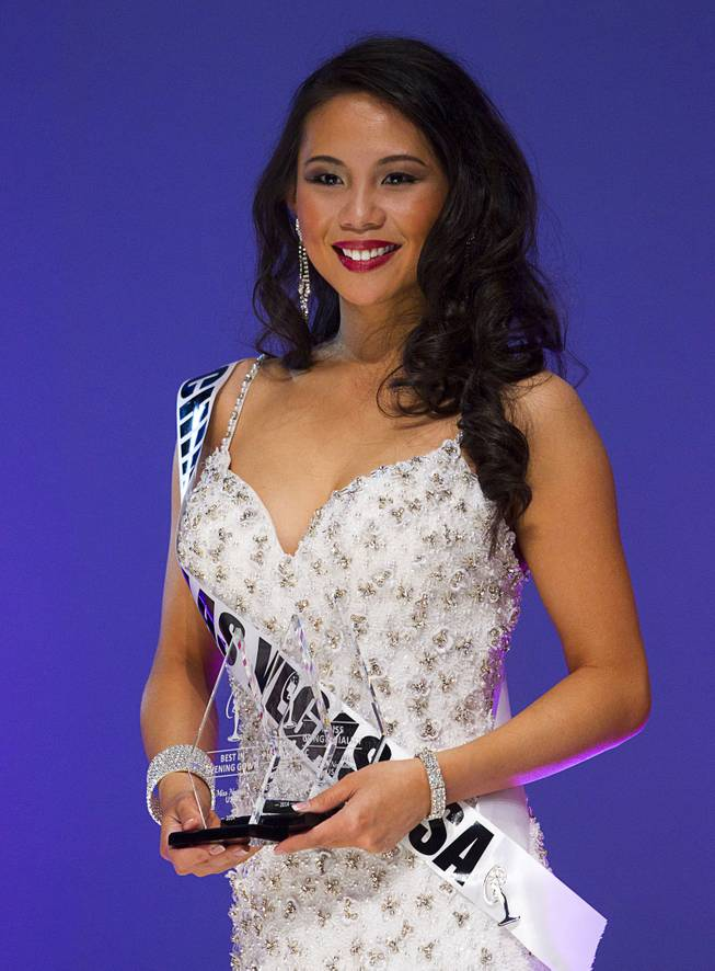 Miss Chinese Las Vegas Elisa Chan is shown during the Miss Nevada USA pageant at UNLV Sunday, Jan. 12, 2014. Chan won awards for Miss Congeniality, Miss Photogenic, and Best In Evening Gown (non-finalist).
