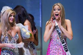 Miss Summerlin Teen USA Alexa Taylor reacts after being named Miss Nevada Teen USA 2014 during the Miss Teen Nevada USA pageant at UNLV Sunday, Jan. 12, 2014. Miss Nevada Teen USA 2013 Amanda Jenkins carries the crown at left.