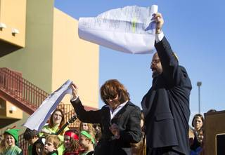 Jacky Rosen, left, congregation president, and Rabbi Sanford Akselrad tear up an oversized NV Energy bill during a news conference to