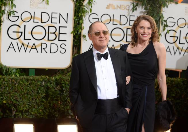 From left, James Spader and Leslie Stefanson arrive at the 71st annual Golden Globe Awards at the Beverly Hilton Hotel on Sunday, Jan. 12, 2014, in Beverly Hills, Calif.