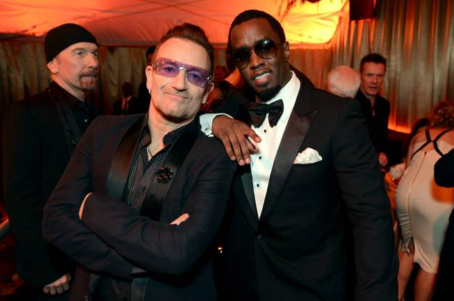 Bono, left, and Sean Combs The Weinstein Company's Golden Globes after party at the Beverly Hilton Hotel on Sunday, Jan. 12, 2014, in Beverly Hills, Calif.