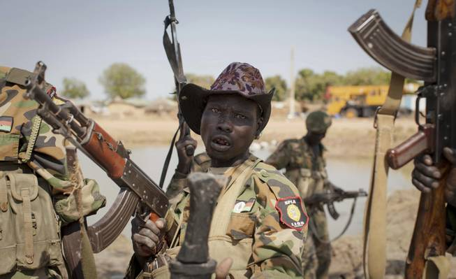A South Sudanese government soldier chants in celebration after government forces on Friday retook from rebel forces the provincial capital of Bentiu, in Unity State, South Sudan, Sunday, Jan 12, 2014.