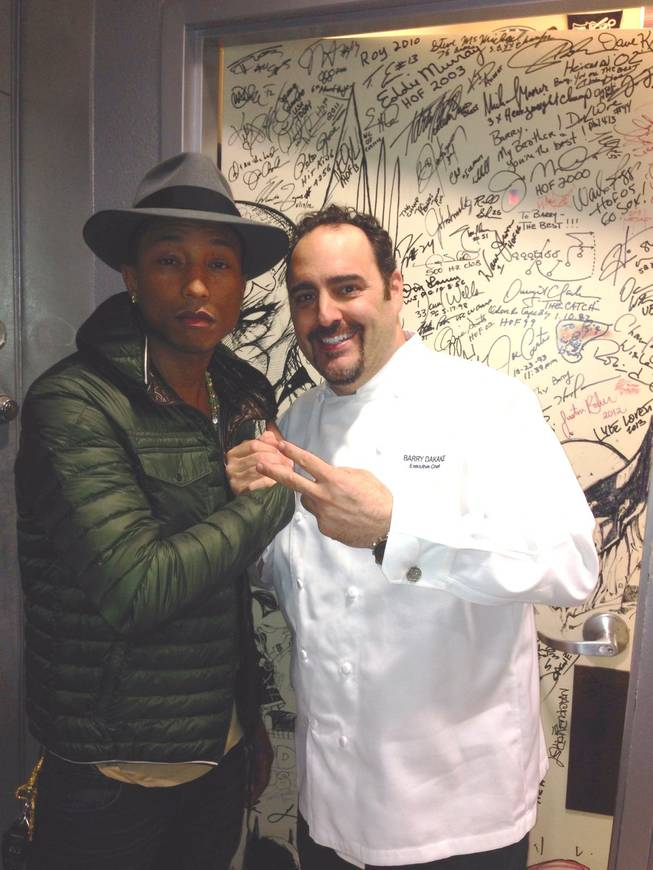 Pharrell Williams and chef Barry Dakake at N9NE Steakhouse on Wednesday, Jan. 8, 2014, in the Palms.