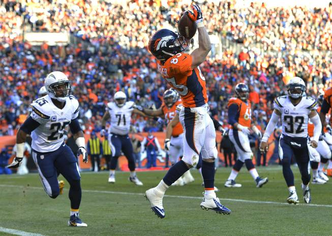 Denver Broncos wide receiver Wes Welker catches a pass for a touchdown against the San Diego Chargers in the second quarter of an NFL playoff game Sunday, Jan. 12, 2014, in Denver.