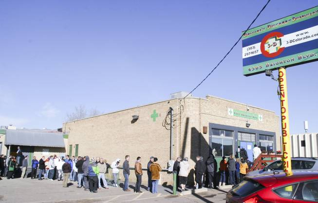 About 85 people wait in line on Jan. 2, 2014, at the 3D Cannabis Center near downtown Denver, one of 36 marijuana dispensaries that opened in Colorado on New Year's Day.
