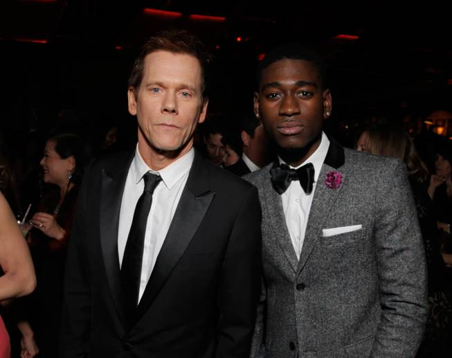 Kevin Bacon, left, and Kwame Boateng attend the FOX after party for the 71st Annual Golden Globes award show on Sunday, Jan. 12, 2014 in Beverly Hills, Calif.