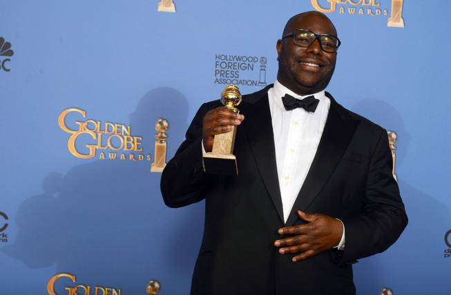 "Steve McQueen poses in the press room with the award for best motion picture - drama for ""12 Years a Slave"" at the 71st annual Golden Globe Awards at the Beverly Hilton Hotel on Sunday, Jan. 12, 2014, in Beverly Hills, Calif."