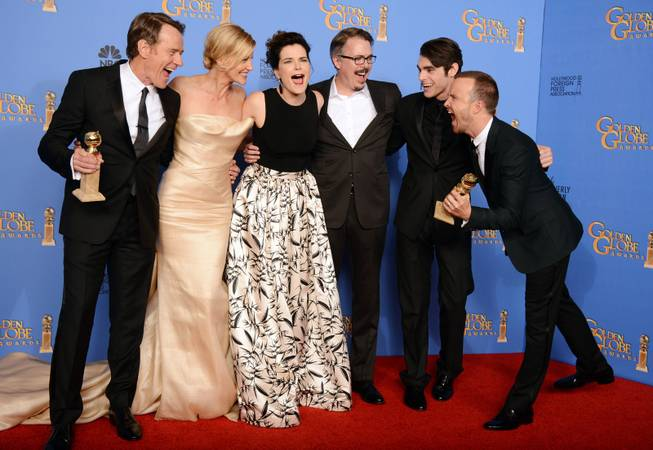 "From left, Bryan Cranston, Anna Gunn, Betsy Brandt, Vince Gilligan, RJ Mitte, and Aaron Paul pose in the press room with the award for Best TV Series — Drama for ""Breaking Bad"" at the 71st annual Golden Globe Awards at the Beverly Hilton Hotel on Sunday, Jan. 12, 2014, in Beverly Hills, Calif."