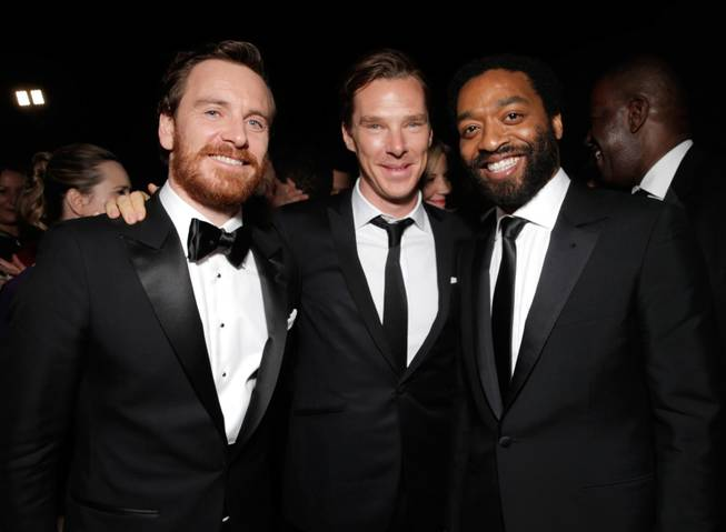 From left, Michael Fassbender, Benedict Cumberbatch, and Steve McQueen winner of Best Motion Picture - Drama for '12 Years a Slave,' attend the FOX after party for the 71st Annual Golden Globes award show on Sunday, Jan. 12, 2014 in Beverly Hills, Calif.