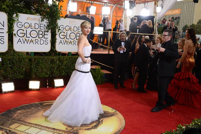 Jennifer Lawrence arrives at the 71st Annual Golden Globe Awards at the Beverly Hilton Hotel on Sunday, Jan. 12, 2014, in Beverly Hills, Calif.