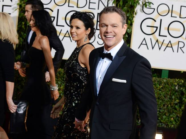 Matt Damon arrives at the 71st annual Golden Globe Awards at the Beverly Hilton Hotel on Sunday, Jan. 12, 2014, in Beverly Hills, Calif.