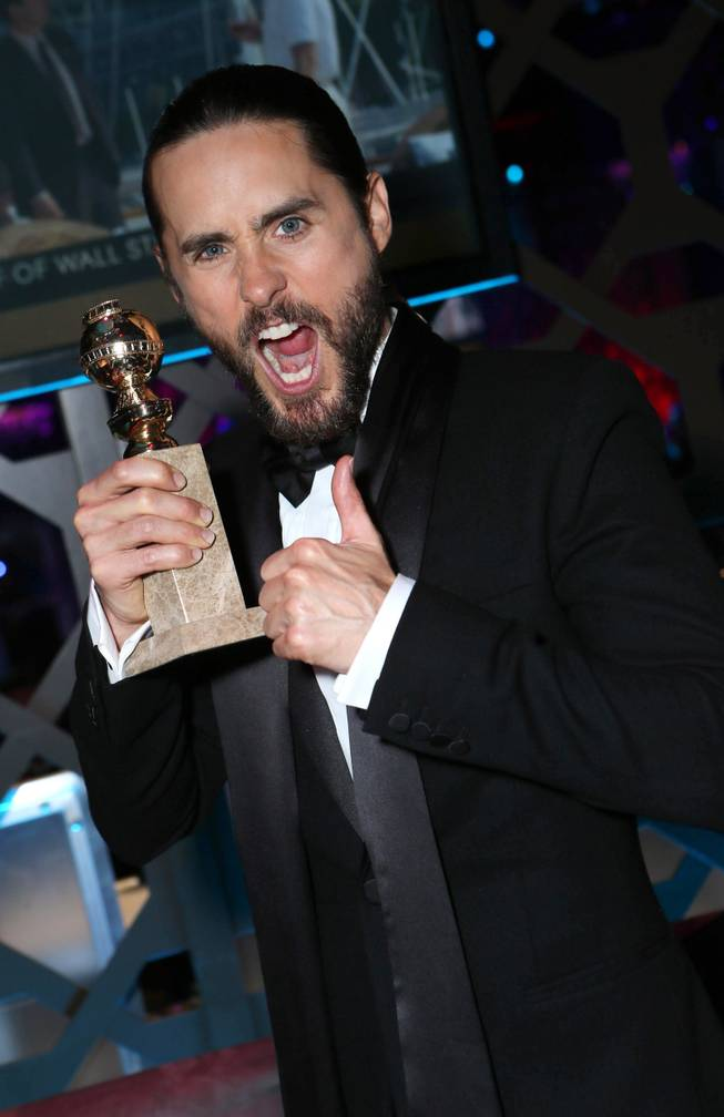 "Jared Leto with the award for best supporting actor in a motion picture for ""Dallas Buyers Club"" at the 71st Annual Golden Globe Awards  NBC/Universal/Focus Features/E! Entertainment/Chrysler After Party on Sunday, Jan. 12, 2014 in Los Angeles."