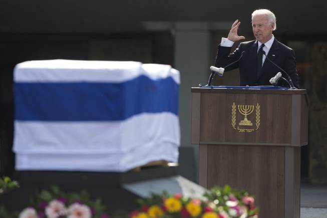 U.S. Vice President Joe Biden delivers a speech next to the coffin of late Israeli Prime Minister Ariel Sharon outside the Knesset, Israel's Parliament, in Jerusalem, Monday, Jan. 13, 2014.