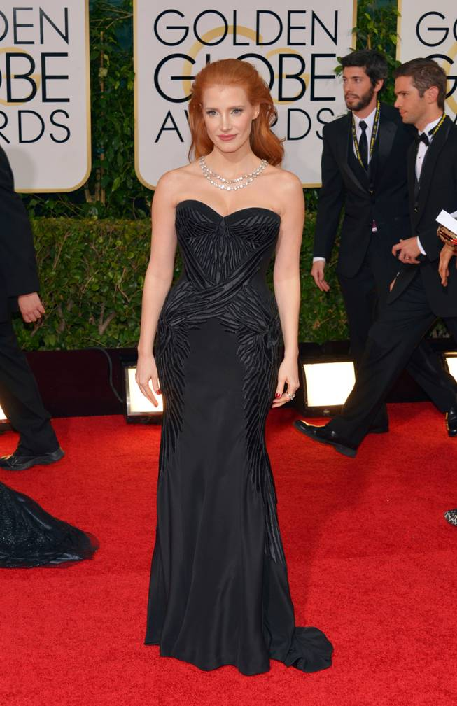 Jessica Chastain arrives at the 71st annual Golden Globe Awards at the Beverly Hilton Hotel on Sunday, Jan. 12, 2014, in Beverly Hills, Calif.