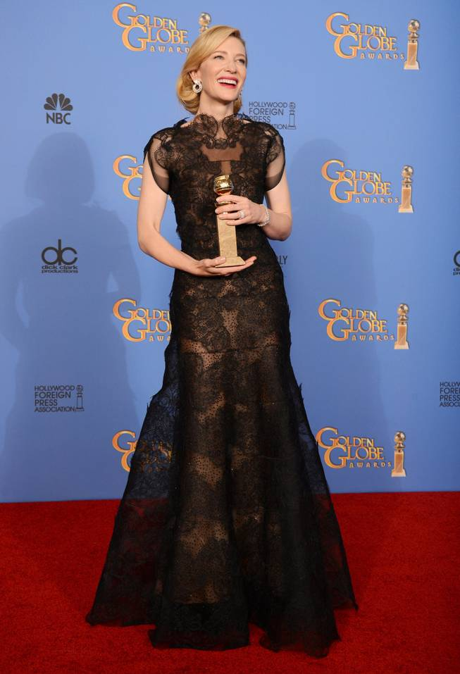 "Cate Blanchett poses in the press room with the award for best actress in a motion picture - drama for ""Blue Jasmine"" at the 71st annual Golden Globe Awards at the Beverly Hilton Hotel on Sunday, Jan. 12, 2014, in Beverly Hills, Calif."