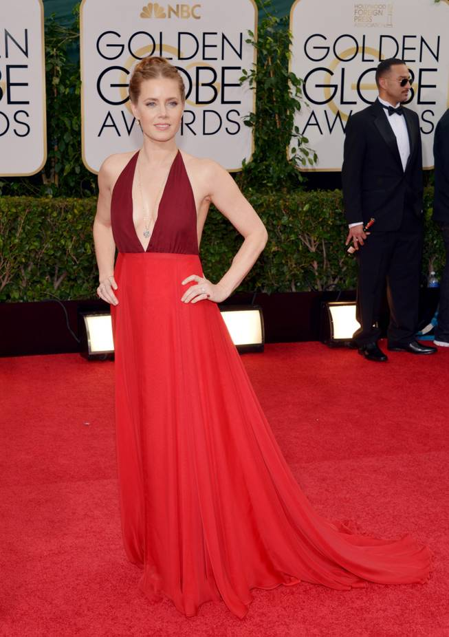 Amy Adams arrives at the 71st annual Golden Globe Awards at the Beverly Hilton Hotel on Sunday, Jan. 12, 2014, in Beverly Hills, Calif.
