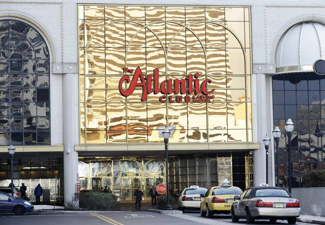 In this Feb. 14, 2013, file photo, the Atlantic Club Casino Hotel is seen in Atlantic City, N.J. On Jan. 12, 2014, customers and employees spent a final few hours at the casino, which closed after midnight.