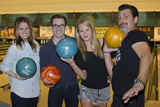 "Becca Kotte, Matt Meigs, Carrie St. Louis and Bob Torti of Rock of Ages at the ""Strikes for Scholarships"" Epicurean Charitable Foundation fundraising event Saturday, Jan. 11, 2014."