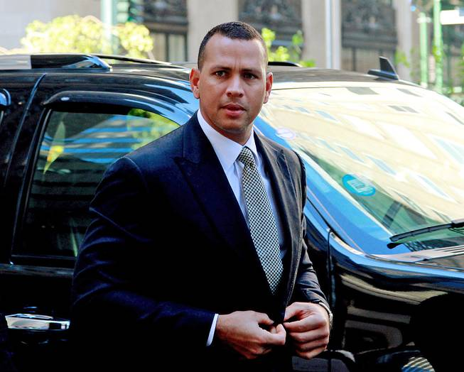 This Oct. 1, 2013, file photo shows New York Yankees' Alex Rodriguez arriving at the offices of Major League Baseball in New York.