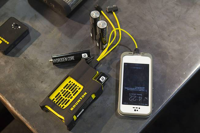 A Brunton Reactor charges a smartphone during the 2014 SHOT Show (Shooting, Hunting, Outdoor Trade) at the Sands Expo & Convention Center Tuesday, Jan. 14, 2014.  The device ($149.00 with two cores) uses hydrogen to generate electricity for recharging USB mobile devices.