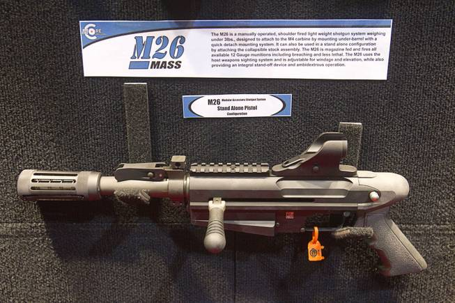 An M26 shotgun pistol is displayed at the C-More booth during the 2014 SHOT Show (Shooting, Hunting, Outdoor Trade) at the Sands Expo & Convention Center Tuesday, Jan. 14, 2014. The gun is designed to attach under the barrel of a M4 carbine.