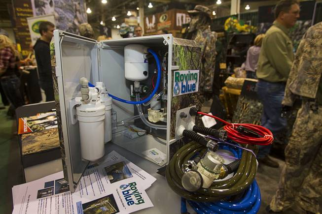 A Roving Blue portable water purifying system is displayed during the 2014 SHOT Show (Shooting, Hunting, Outdoor Trade) at the Sands Expo & Convention Center Tuesday, Jan. 14, 2014. The system, which weighs less than 15 pounds and is powered by a 12-volt battery, can produce one liter of purified water per minute.