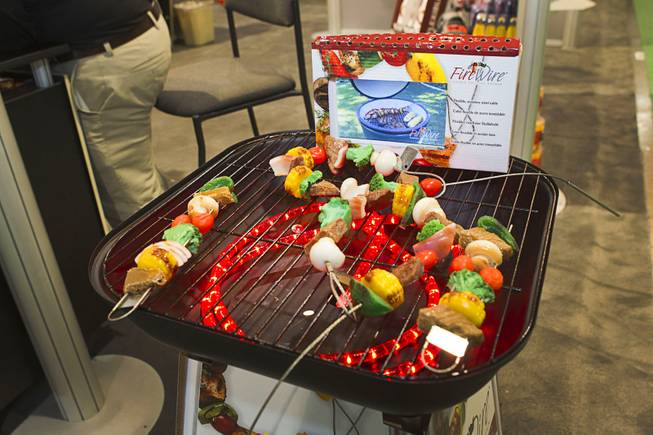 Firewire flexible grilling skewers are displayed during the 2014 SHOT Show (Shooting, Hunting, Outdoor Trade) at the Sands Expo & Convention Center Tuesday, Jan. 14, 2014. A Firewire two-pack retails for $9.95.