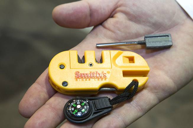 A Pocketpal X2 is displayed at the Smith's Consumer Product booth during the 2014 SHOT Show (Shooting, Hunting, Outdoor Trade) at the Sands Expo & Convention Center Tuesday, Jan. 14, 2014. The $15 survival tool includes a knife sharpener, a fire starter, an LED light, a compass and a signal whistle.