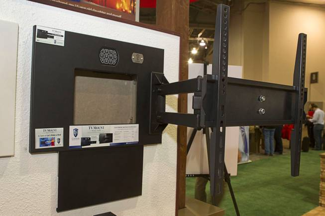 A Cannon Security products gun safe is shown behind a flat panel television wall mount during the 2014 SHOT Show (Shooting, Hunting, Outdoor Trade) at the Sands Expo & Convention Center Tuesday, Jan. 14, 2014. The safe retails for $349.00.