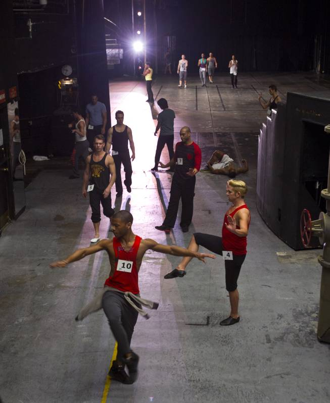 "Male dancers warm up in the wings as others run through a choreographed piece during ""Jubilee!"" auditions on Tuesday, Jan. 14, 2014."