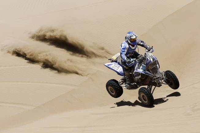 Yamaha rider Sergio Lafuente, of Uruguay, races across the dunes during the ninth stage of the Dakar Rally between the cities of Calama and Iquique, Chile, Tuesday, Jan. 14, 2014.