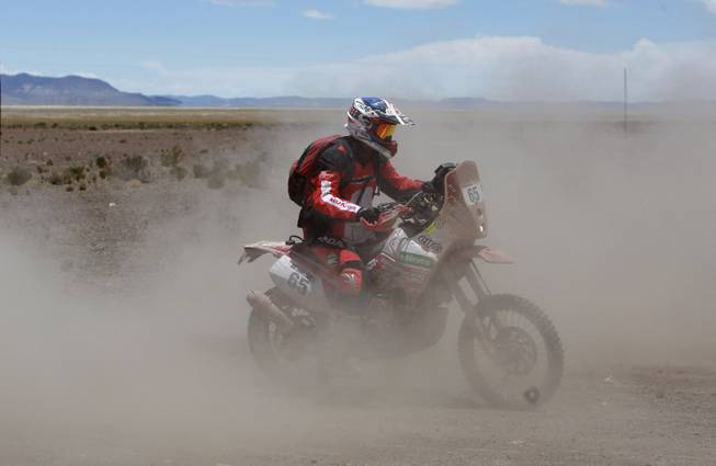 Honda rider Eduardo Heinrich of Peru races during the eighth stage of the Dakar Rally between the cities Uyuni, Bolivia and Calama, Chile in Kui, Bolivia, Monday, Jan. 13, 2014.