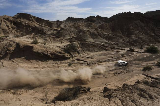 Mini driver Martin Kaczmarski of Poland and co-pilot Filipe Palmeiro of Portugal race during the fourth stage of the Dakar Rally between the cities of San Juan and Chilecito, Argentina, Wednesday, Jan. 8, 2014.