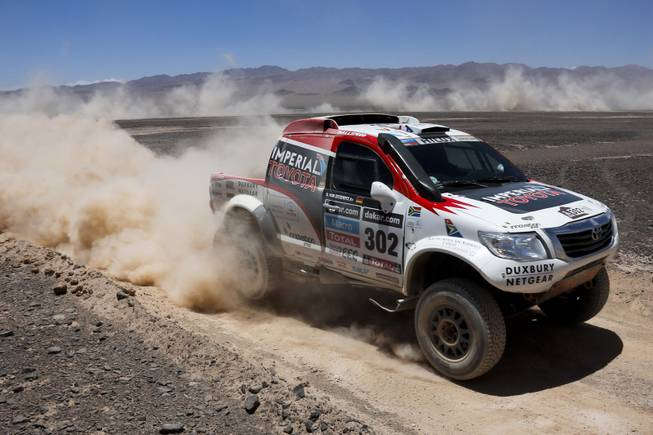 Toyota driver Giniel de Villiers of South Africa and co-pilot Dirk Von Zitzewitz of Germany race during the eight stage of the Dakar Rally between the cities of Salta, Argentina, and Calama, Chile, Monday, Jan. 13, 2014.