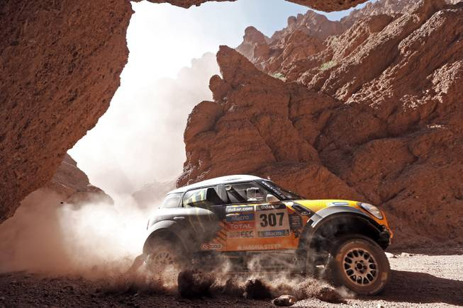 Mini driver Orlando Terranova of Argentina and co-pilot Paulo Fiuza of Portugal race during the Dakar Rally between the cities of San Miguel de Tucuman and Salta, Argentina, Friday, Jan. 10, 2014.