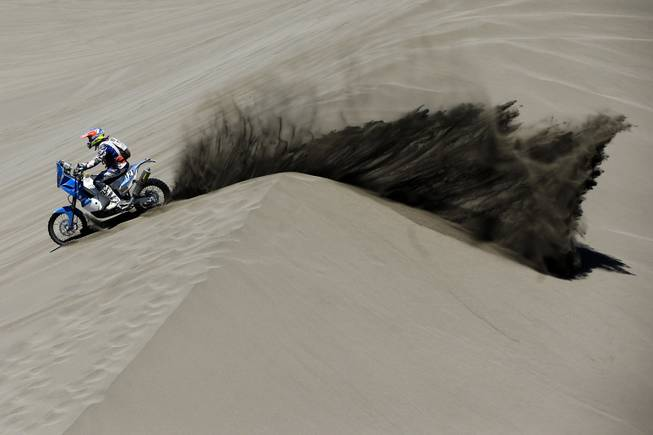 KTM rider Mark Davidson of Australia races through the dunes during the second stage of the Dakar Rally between the cities of San Luis and San Rafael in San Rafael, Argentina,  Monday, Jan. 6, 2014. The second stage is regarded as one of the fastest in the two-week rally, which ends Jan. 18 in Valparaiso, Chile.