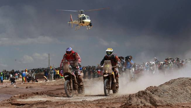 Speedbrain rider Jeremias Isarael Esquerre of Chile, left center,  and KTM rider Jordi Viladoms of Spain race during the seventh stage of the Dakar Rally between the cities of Salta, Argentina and Uyuni Bolivia, Sunday, Jan. 12, 2014.